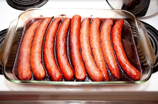 Sausages marinating in red wine.