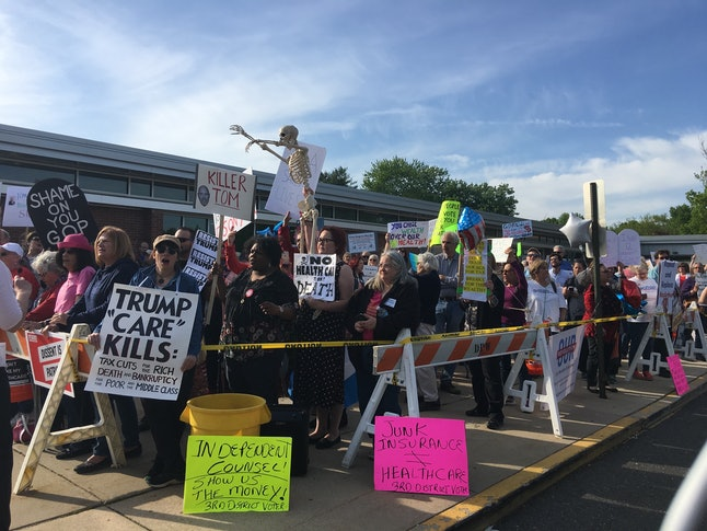 Demonstrators gather outside a town hall event with Rep. Tom MacArthur in New Jersey on May 10, 2017.