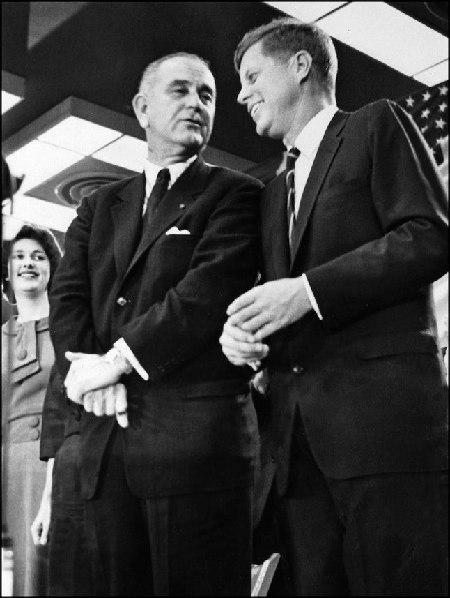President John F. Kennedy and then-Vice President Lyndon B. Johnson, who assumed the presidency after Kennedy's assassination.