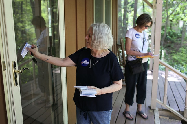 Ossoff supporters knock on doors to get out the vote for Tuesday's special election in Georgia's 6th District.