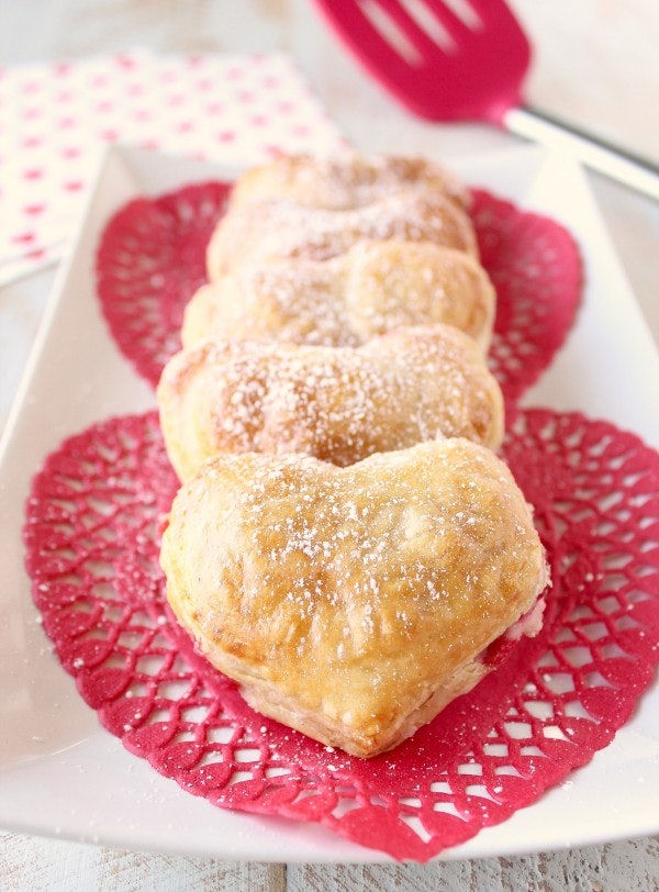 Heart-shaped strawberry cheesecake puff pastry pies