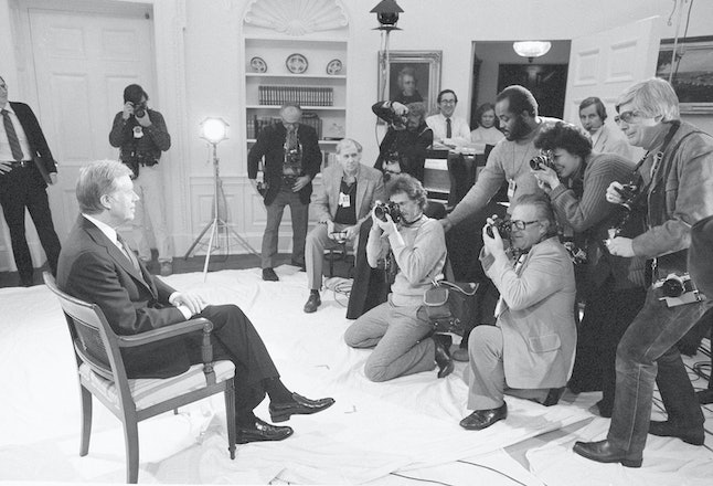 Former President Jimmy Carter posing for photographs before delivering his farewell address.