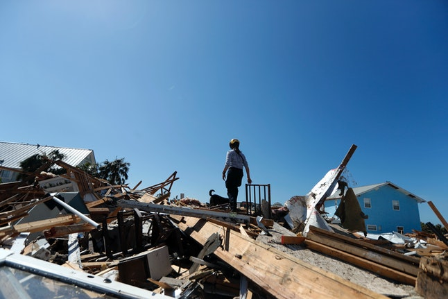 Lynn Ballard and search dog Toby of Missouri Task Force 1 — an urban search-and-rescue team — examine rubble in the aftermath of Hurricane Michael in Mexico Beach, Florida, on Wednesday.