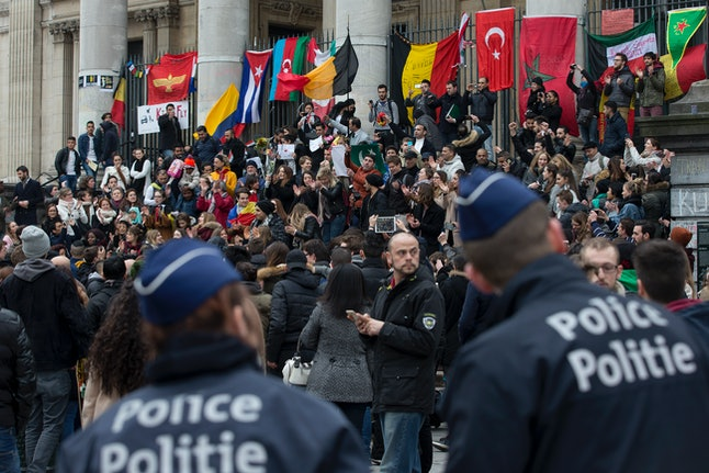 Police patrol as people mourn the victims of the Brussels attack.