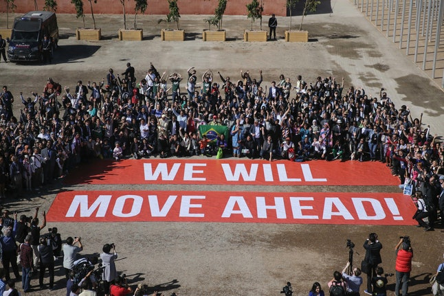 Participants at the COP22 climate conference stage a public show of support for climate negotiations and Paris agreement, on the last day of the conference, in Marrakech, Morocco, Friday, Nov. 18, 2016.