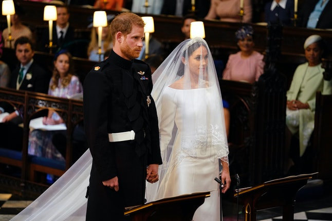 Prince Harry and Meghan Markle stand at St. George's Chapel in Windsor Castle.