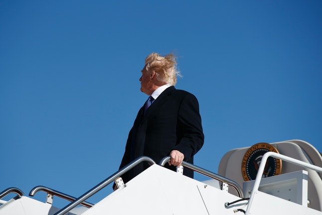 President Donald Trump boards Air Force One in February.