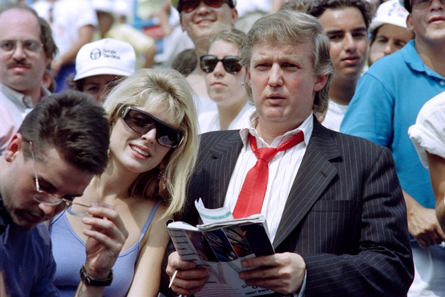 Donald Trump and ex-wife Marla Maples watch a golf tournament.