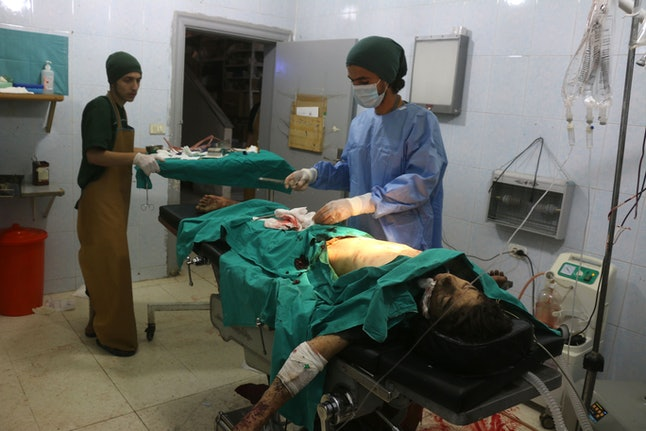 Doctors treat a man wounded in an airstrike in Aleppo's Tariq al-Bab neighborhood on Aug. 16.
