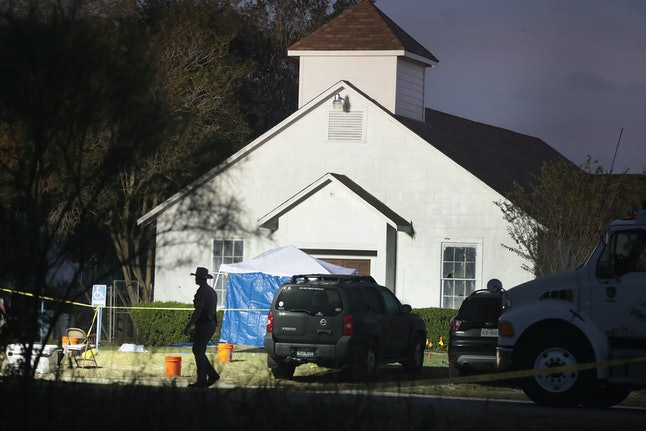Law enforcement officials continue their investigation at First Baptist Church in Sutherland Springs, Texas.