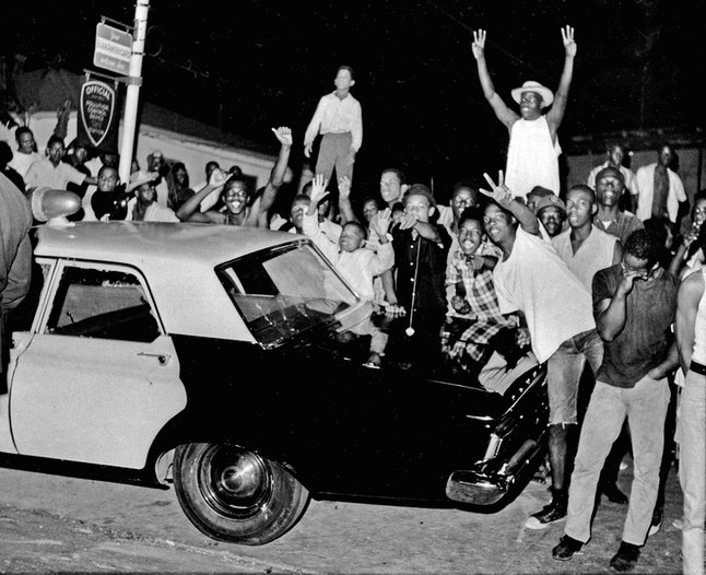 Demonstrators gather in the Watts section of South Central Los Angeles —a few miles from where the author's mother grew up —in 1965.