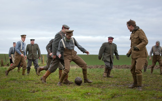 Re-enactors, from various living history groups, are dressed in World War I British and German uniforms as they kick around a soccer ball during a re-enactment of the 1914 Christmas Truce in Ploegsteert, Belgium on Saturday, Dec. 20, 2014. During that first Christmas Day in World War I, something magical happened. Soldiers who had been killing each other by the tens of thousands for months climbed out of their muddy trenches to seek a shred of humanity amid the horrors of war. Hands reached out across the narrow divide, presents were exchanged, and in Flanders Fields a century ago, a spontaneous Christmas truce briefly lifted the human spirit.