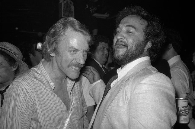 """Animal House"" stars Donald Sutherland and John Belushi at the movie's premiere party"