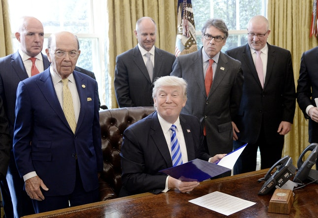 Donald Trump holds a National Economic Council meeting in the Oval Office in March.