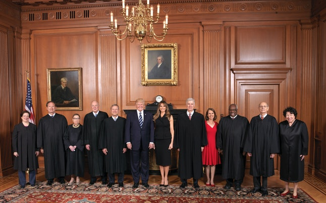 President Donald Trump and first lady Melania Trump pose with members of the Supreme Court.