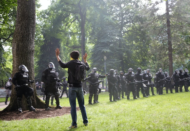 "In Portland, Oregon, anti-fascist demonstrators showed up to a ""Trump Free Speech"" rally, and were met with a heavily armored police force."