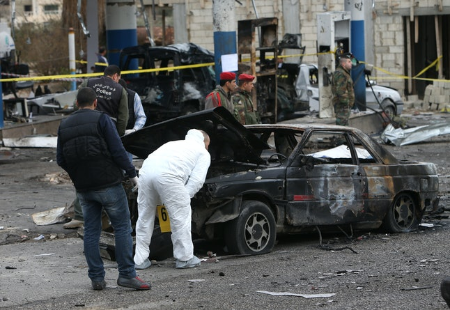 Lebanese investigators scan the scene of a car bombing in Hermel in 2014. Some researchers believe drought and poor harvests have contributed to the destabilization of the region, adding to the misery of the civil wars in Iraq and Syria.