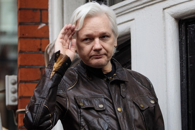 Julian Assange gestures as he speaks to the media from the balcony of the Embassy of Ecuador in London in May.