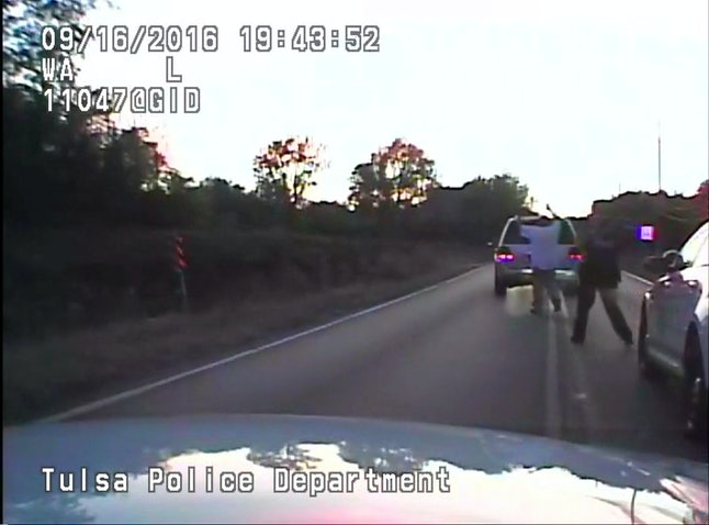 Another screen capture of police video shows Terence Crutchers with his hands raised and his back turned to Tulsa officers.