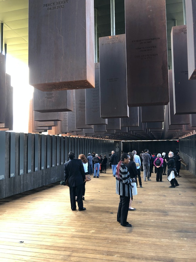 At the National Memorial for Peace and Justice in Montgomery, Alabama, visitors make their way through the memorial.