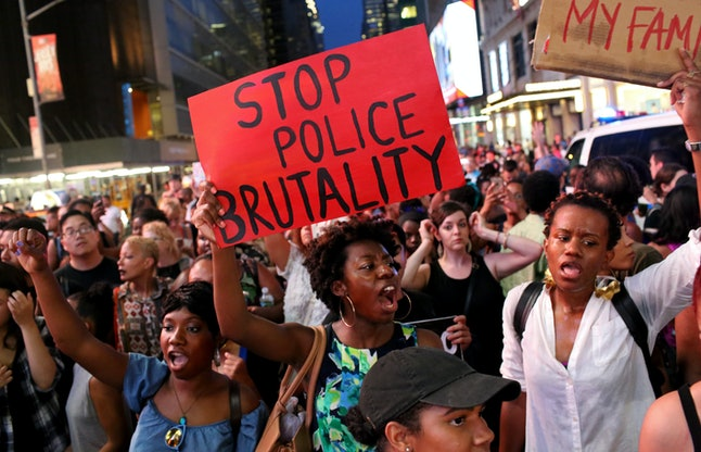 Protestors march through New York City's Times Square in July.