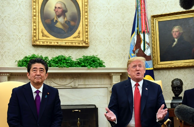 President Donald Trump smiles during his meeting Thursday with Japanese Prime Minister Shinzo Abe at the White House.
