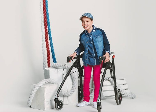 A model wearing Hilfiger's second adaptive clothing collection for children
