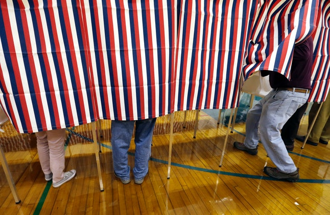 A voter enters a polling booth in Exeter, New Hampshire on Tuesday, Nov. 8.