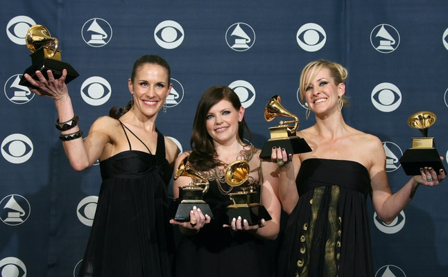 The Dixie Chicks, Emily Robison, left, Natalie Maines, center, and Martie Maguire, right, pose with their trophies at the 49th Grammy Awards in Los Angeles, Feb. 11, 2007.