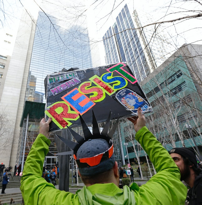A protester holds a sign during a demonstration in front of the federal courthouse in Seattle, where a hearing was held for Daniel Ramirez Medina, who was arrested by immigration agents despite his participation in a federal program to protect those brought to the U.S. illegally as children.