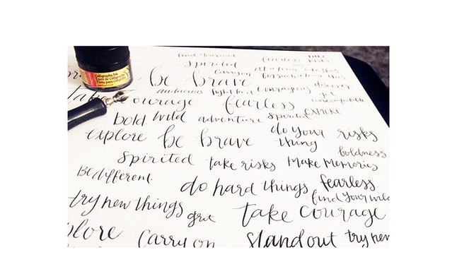 Alexandra Moore diligently practices her hand-lettering by writing inspirational phrases.