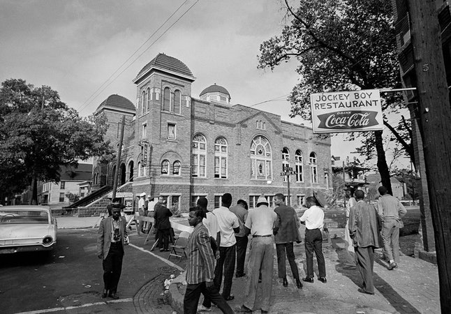 A state trooper and two plainclothes men stand guard at a roadblock at the 16th Street Baptist Church in Birmingham, Alabama, after the 1963 bombing that killed four young girls.