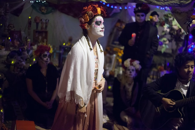 A woman sings at the event of the Day of the Dead, Mission District, San Francisco in November 2014.