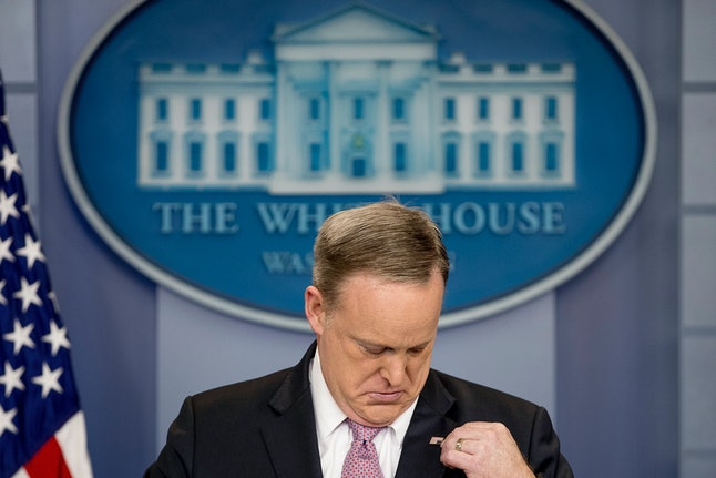 Sean Spicer rights his pin.