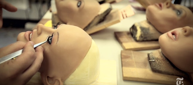 RealDoll heads being painted by creator Matt McMullen.