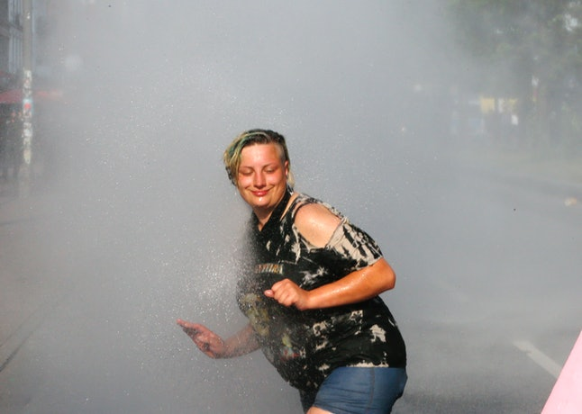 A demonstrator is showered by a water cannon during a protest in Hamburg on July 7.