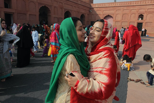 Pakistani Muslims greet each other after the Eid al-Adha prayer in Lahore, Pakistan.
