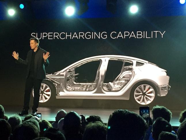 Tesla CEO Elon Musk revealing the Tesla Model 3