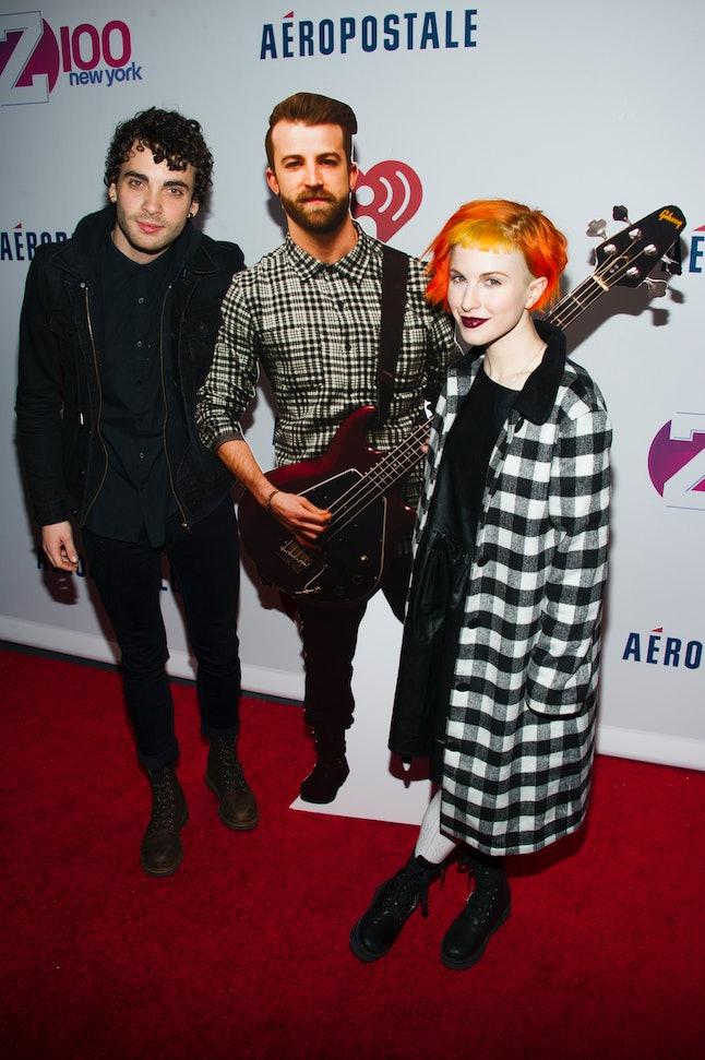 Paramore posing with a cardboard cutout of Davis at the 2013 Jingleball