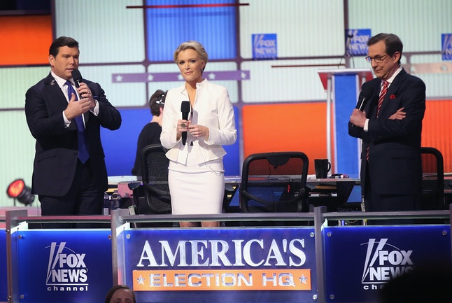 Chris Wallace, at right, at the Fox News Republican presidential primary debate in March.