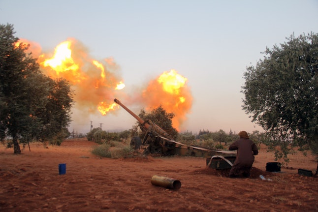 Fighters affiliated with Islamist group Ajnad al-Sham fire artillery from near Aleppo's south.