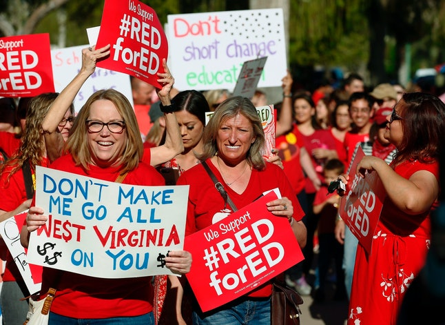 Arizona teachers and education advocates march at the Arizona Capitol protesting low teacher pay and school funding in Phoenix on Wednesday.