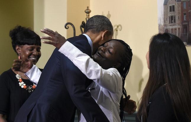 President Barack Obama greets Stephanie Luna, a resident at Integrity House.