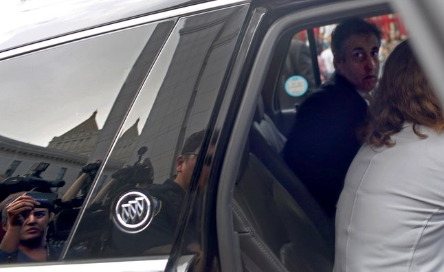Michael Cohen leaves a federal courthouse Tuesday after pleading guilty to eight charges, including two campaign finance violations.