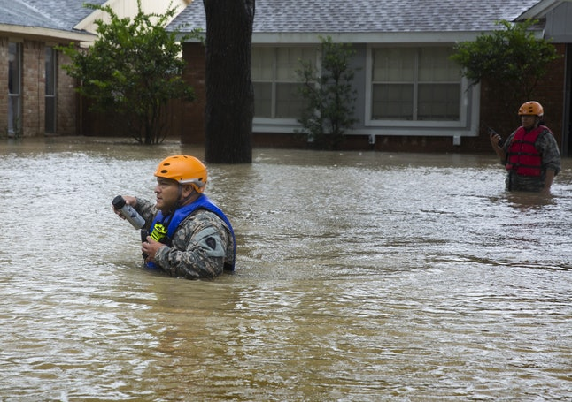 Luis Perez of the Texas Army National Guard goes house-to-house in search of people who need rescuing from flooded homes in Houston.