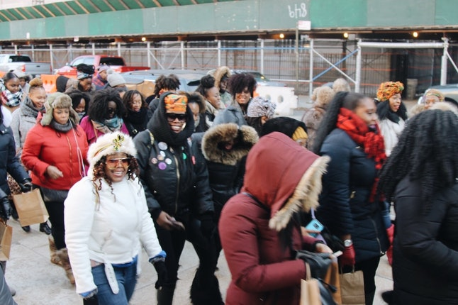 Crowds of revelers leaving St. Francis de Sales School for the Deaf in Brooklyn on Tuesday to kick off Kwanzaa Crawl.