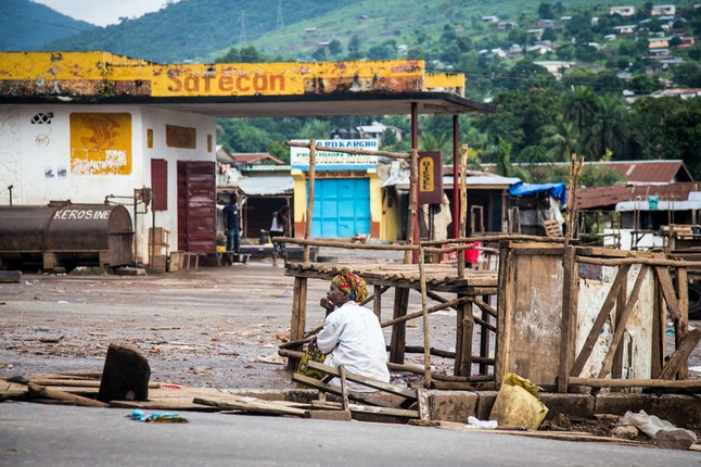 A trader sits at an empty local market area in Waterloo, as Sierra Leone government enforces a three day lock down on movement of all people in an attempt to fight the Ebola virus, in Freetown, Sierra Leone, Friday, Sept. 19, 2014