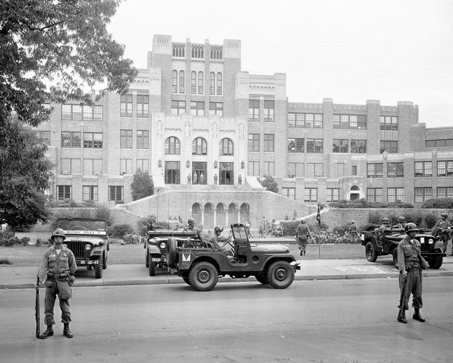 Members of the 101st Airborne Division take up positions outside Central High School in Little Rock, Arkansas, after President Dwight D. Eisenhower ordered them into the city to enforce integration at the school on Sept. 26, 1957.