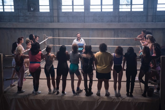 The women wrestlers of 'GLOW' including Ellen Wong, Kate Nash, Sydelle Noel, Kia Stevens, Gayle Rankin, Britney Young, Alison Brie, Jackie Tohn, Marianna Palka and Rebekka Johnson, standing around their training ring with Marc Maron.
