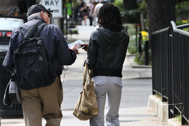 Man follows woman down street in Washington, D.C., to give her anti-abortion literature.